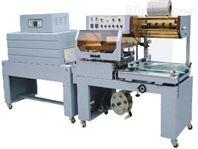 全自动彩膜定位套膜封切机 全自动直线输送式胶带套膜封切包装机